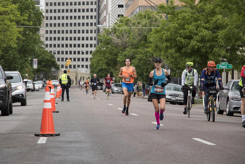 Runners head down 17th Avenue in the annual Colfax Marathon's final leg, May 20, 2018. (Kevin J. Beaty/Denverite)  kevinjbeaty; denverite; colorado; denver; north capitol hill; uptown; colfax marathon; running; race;
