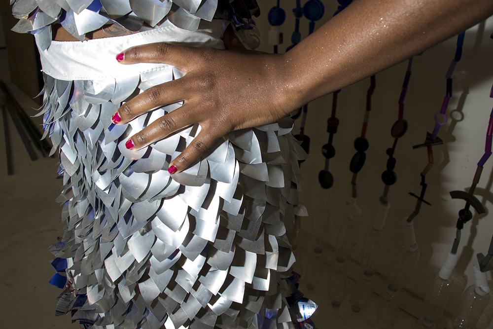 Model Jasiah Paris sports a dress made from Red Bull cans. Lonnie Hanzon's Lakewood studio, May 29, 2018. (Kevin J. Beaty/Denverite)  lakewood; colorado; denverite; kevinjbeaty; sustainability; fashion; pridefest; pride; lgbtq; art;