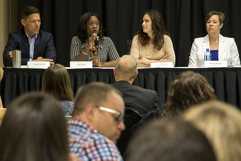 "Developer W. Craig Fitchett (left to right), realtor Lori Pace, marketing manager Diane Eichler and Denver City Council representative at-large Robin Kneich speaks on the Denver Metro Association of Realtors' panel, ""Gentrification or Revitalization?"" May 22, 2018. (Kevin J. Beaty/Denverite)  denver; colorado; denverite; kevinjbeaty;"