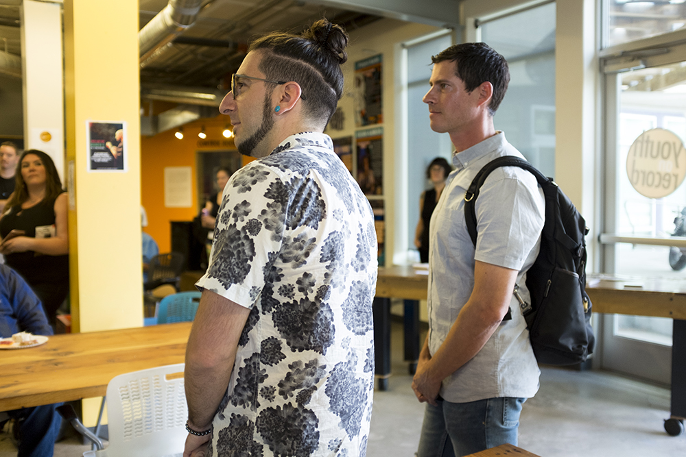 Jeremy Salken (left) and Dominic Lalli of Big Gigantic are recognized for funding Youth on Record's new digital music production lab in their Lincoln Park headquarters, May 23, 2018. (Kevin J. Beaty/Denverite)  denver; colorado; denverite; kevinjbeaty; youth on record; music; mariposa; lincoln park;