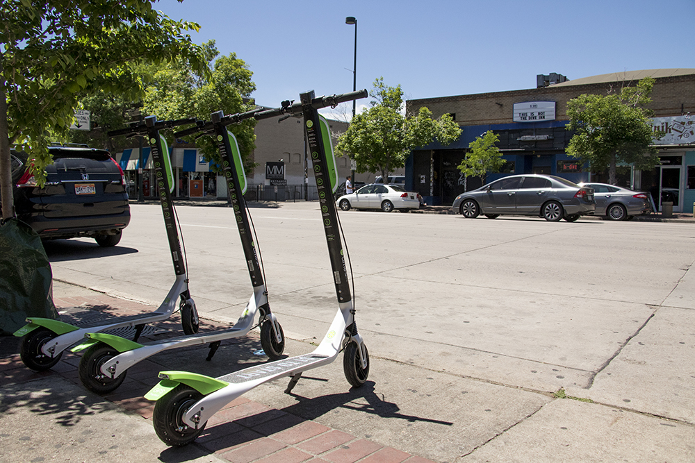 Lime's launches its dockless electric scooters parked outside of Mutiny Information Cafe, May 25, 2018. (Kevin J. Beaty/Denverite)  denver; colorado; denverite; transportation; lime; south broadway; kevinjbeaty; scooters;