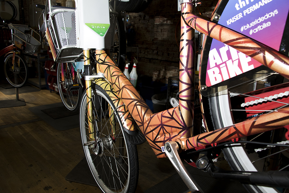 Anthony Garcia's custom B-Cycle. Denver B-Cycle and Kaiser Permanente unveil four hand-painted bikes at their headquarters on Larimer Street, May 31, 2018. (Kevin J. Beaty/Denverite)  denver; colorado; denverite; b-cycle; bikes; bicycles; rino; five points; transportation; art; public art; kevinjbeaty;