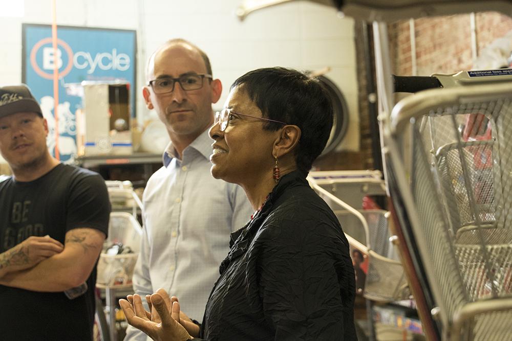 Jandel Allen-Aavis, a vice president at Kaiser Permanente, helps unveil four hand-painted B-Cycles, May 31, 2018. (Kevin J. Beaty/Denverite)  denver; colorado; denverite; b-cycle; bikes; bicycles; rino; five points; transportation; art; public art; kevinjbeaty;