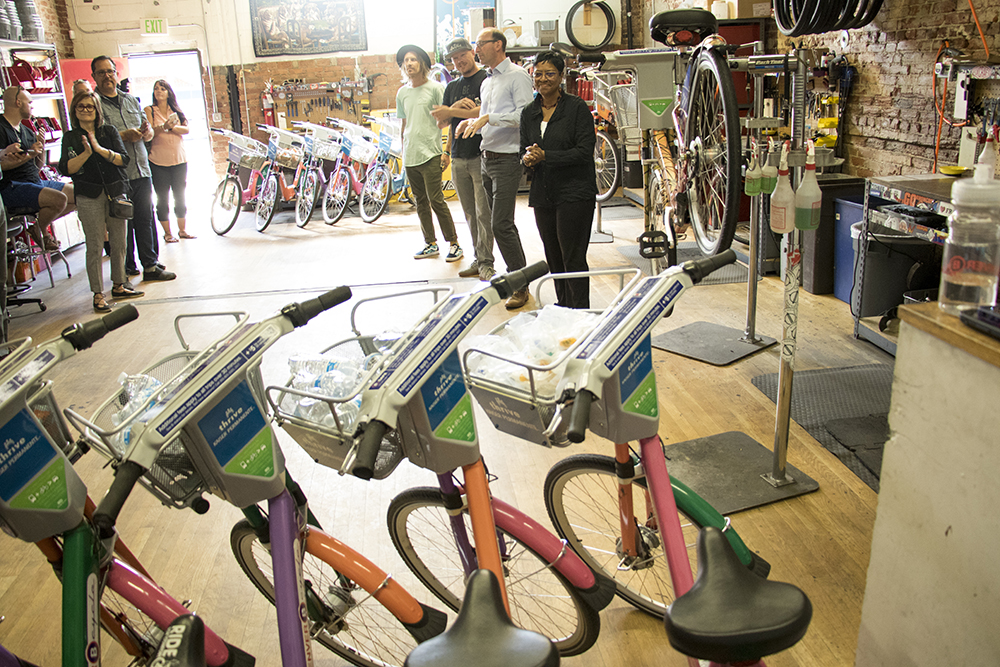 Denver B-Cycle and Kaiser Permanente unveil four hand-painted bikes at their headquarters on Larimer Street, May 31, 2018. (Kevin J. Beaty/Denverite)  denver; colorado; denverite; b-cycle; bikes; bicycles; rino; five points; transportation; art; public art; kevinjbeaty;