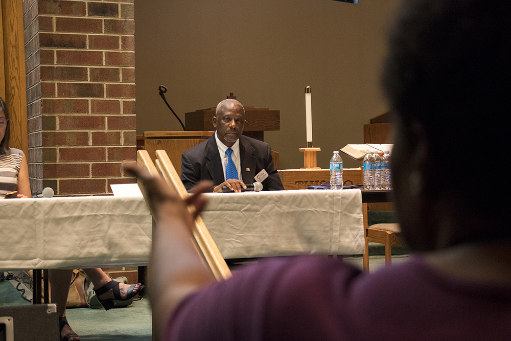 Peggy Burress questions CD1 candidate Casper Stockham who's representing Greg Lopez in a forum on homelessness and housing at the Shorter Community AME Church, May 31, 2018. (Kevin J. Beaty/Denverite)  denver; colorado; denverite; kevinjbeaty; copolitics; shorter community ame church;