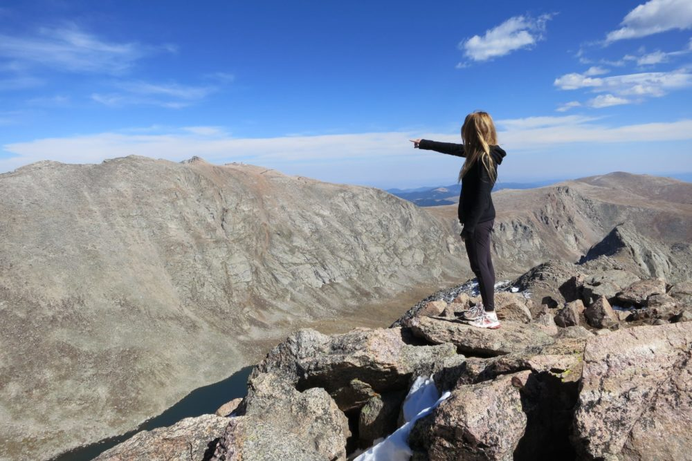 Your author pointing at Mt Evans from atop Mt. Bierstadt. (Courtesy of Gordon Dean)