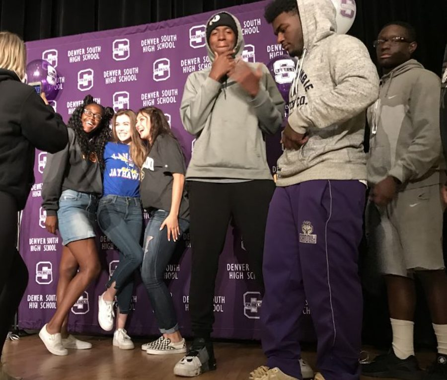 Seniors at Denver's South High School pose after an assembly about college enrollment. (Melanie Asmar/Chalkbeat)