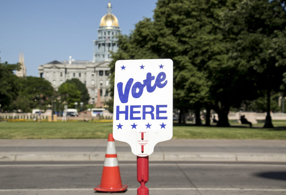VOTE HERE, set up in front of the City and County Building. June 11, 2018. (Kevin J. Beaty/Denverite)