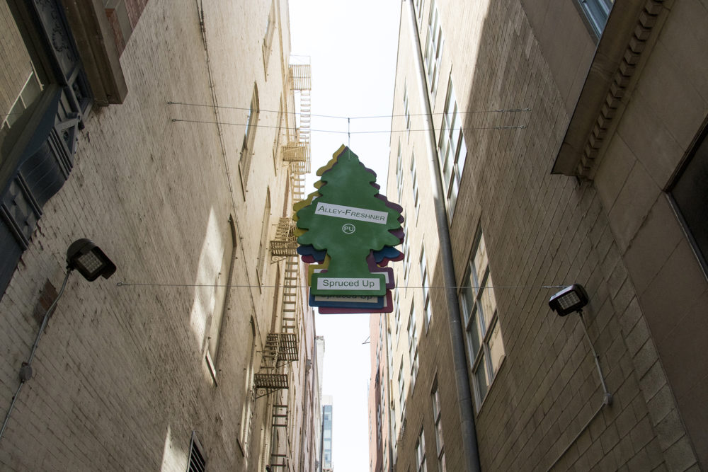 """""""Alley Freshener"""" by Carlos Frésquez, part of """"Between Us: The Downtown Denver Alleyways Project"""" between Stout and California Streets off the 16th Street Mall. June 12, 2018. (Kevin J. Beaty/Denverite)"""