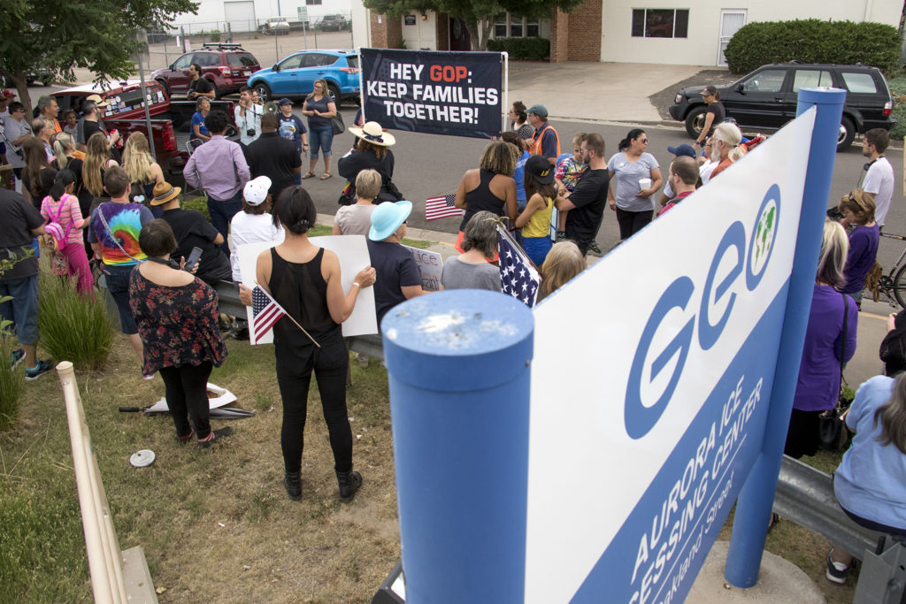 Protesters gather outside of the GEO private immigrant detention facility in Aurora to speak out against child separations in immigration cases, June 14, 2018. (Kevin J. Beaty/Denverite)