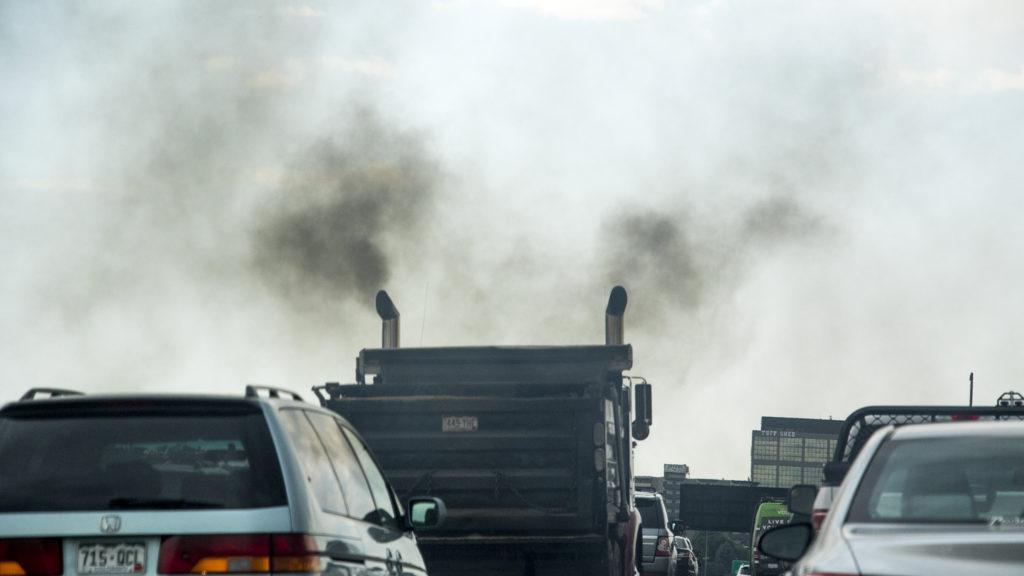 A truck belches exhaust on I-25, June 15, 2018. (Kevin J. Beaty/Denverite)