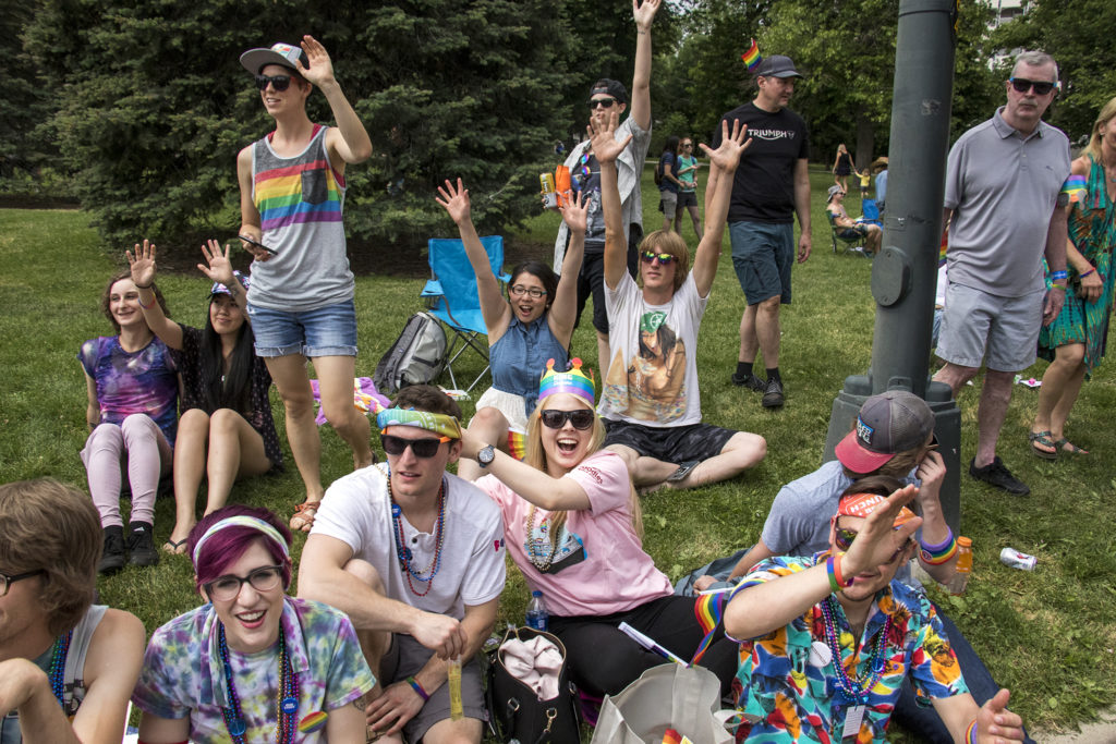 Spectators watch as the Denver PrideFest parade processes out of Cheesman Park, June 17, 2018. (Kevin J. Beaty/Denverite)