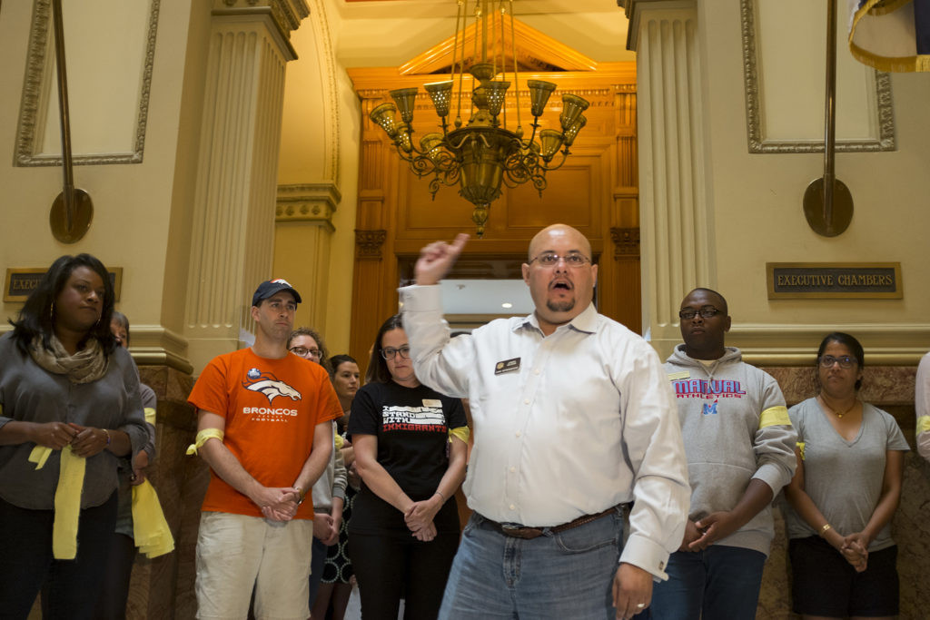 State Representative and candidate for attorney general Joe Salazar speaks to a crowd gathered outside of Governor Hickenlooper's office in protest of family separations in immigration cases at the U.S. border, June 18, 2018. (Kevin J. Beaty/Denverite)