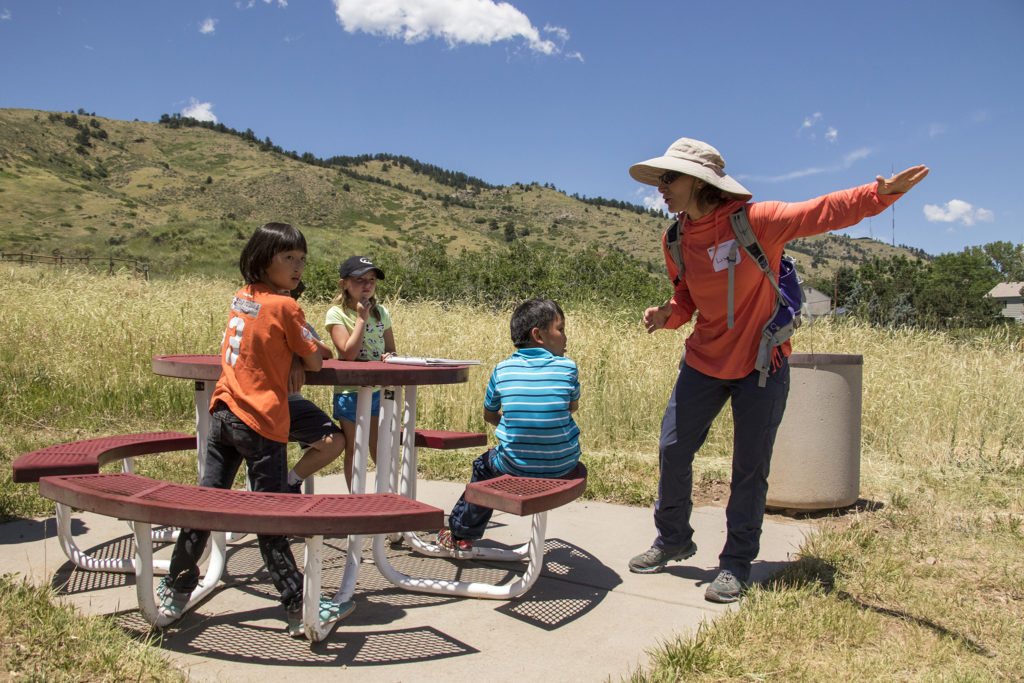 Lisa Yemma leads a tour of Magic Mountain, an archaeological dig site run by Michelle Koons of the Denver Museum of Nature and Science, June 22, 2018. (Kevin J. Beaty/Denverite)