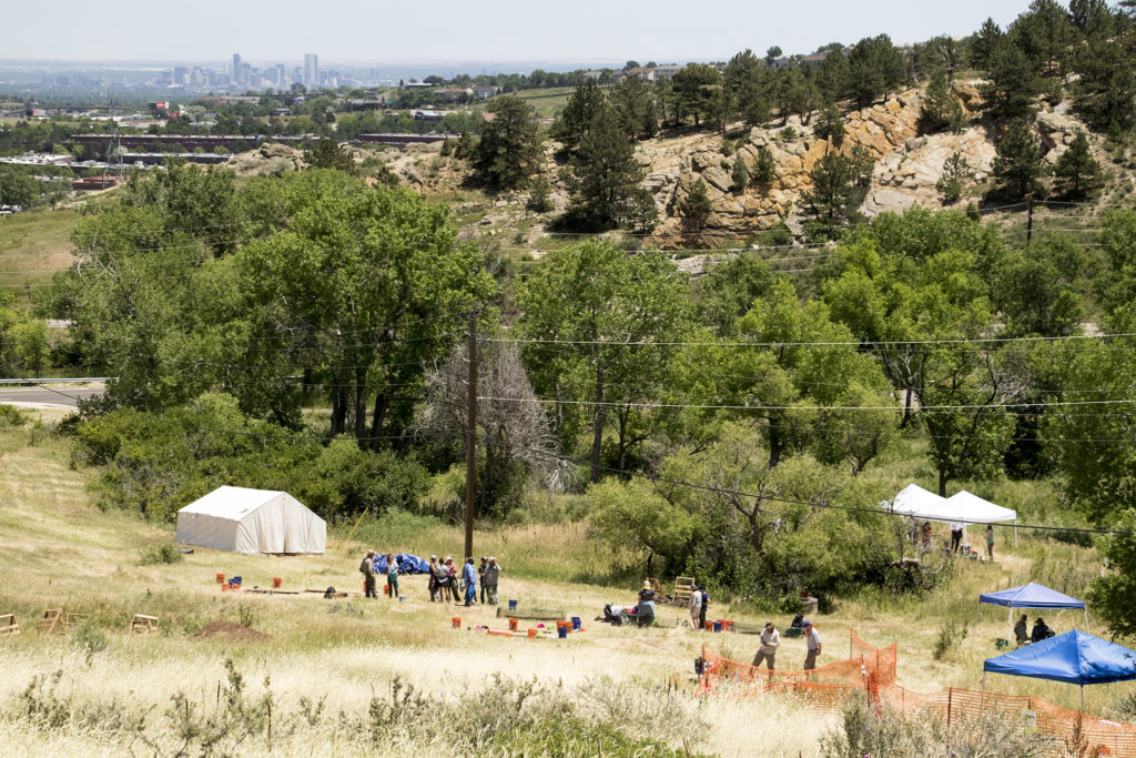 Denver in the distance and, below, Magic Mountain, an archaeological dig site run by Michelle Koons of the Denver Museum of Nature and Science, June 22, 2018. (Kevin J. Beaty/Denverite)