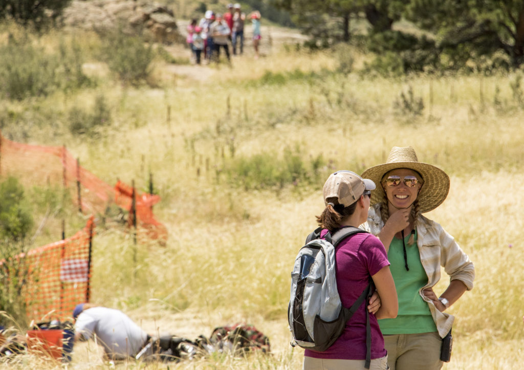 Michelle Koons chats with Debbie Budden at Magic Mountain, an archaeological dig site in Golden, June 22, 2018. (Kevin J. Beaty/Denverite)