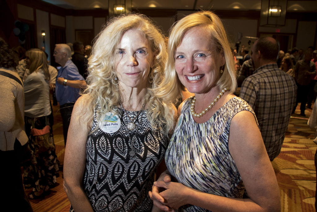 Jennifer Seigel (right), 53, and Ann Barry, 59, pose for a portrait during Jared Polis' watch party at the Renaissance in Broomfield, June 26, 2018. (Kevin J. Beaty/Denverite)