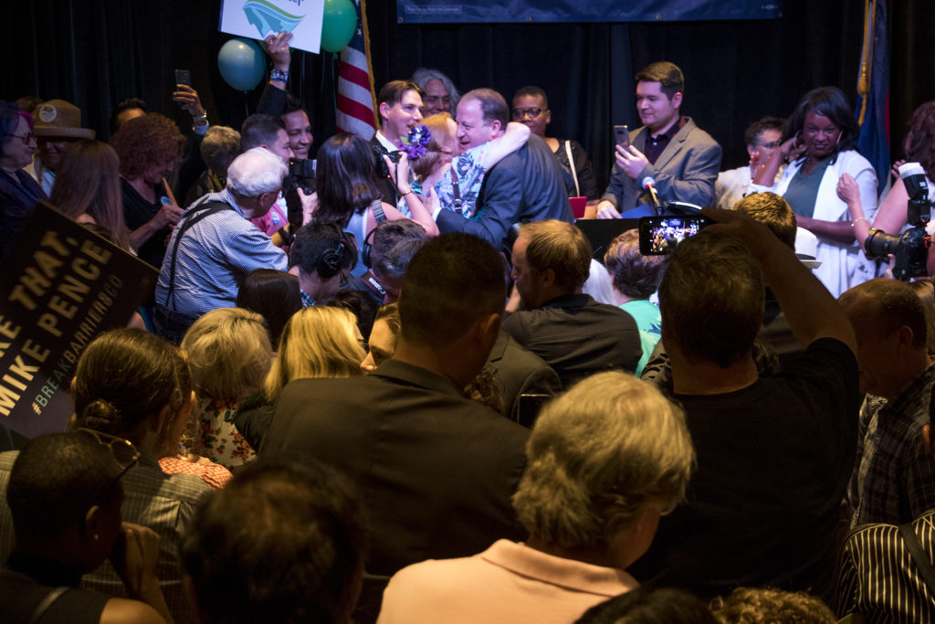 Jared Polis greets elated supporters at his primary election watch party after he was named the Democratic candidate for governor, June 26, 2018. (Kevin J. Beaty/Denverite)