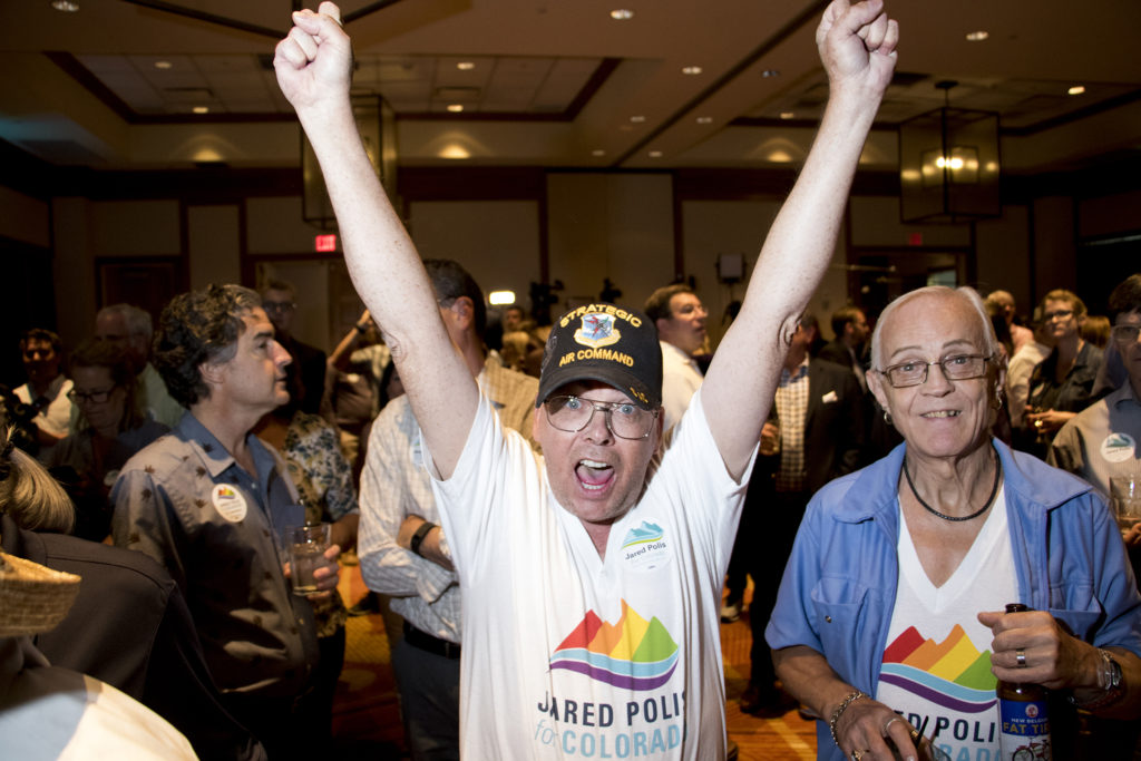 Don Ivins-McCleary, 52, cheers after multiple media outlets called Jared Polis as Colorado's gubernatorial candidate, June 26, 2018. (Kevin J. Beaty/Denverite)