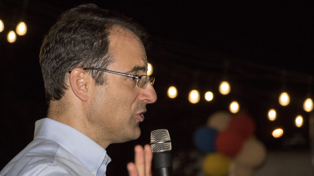 Phil Weiser adjourns his supporters after results in the attorney general race was still inconclusive late into his watch party at Backyard On Blake in RiNo, June 26, 2018. (Kevin J. Beaty/Denverite)