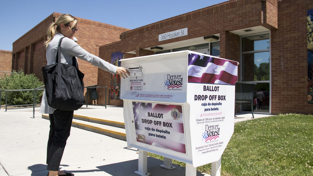 Courtney Leas casrs a ballot on primary election day at the Barnum Recreation Center, June 26, 2018. (Kevin J. Beaty/Denverite)
