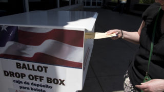 Lisa Lockman casts a ballot at the Denver Human Services building in Sun Valley on primary election day, June 26, 2018. (Kevin J. Beaty/Denverite)