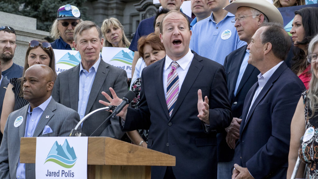 Democratic gubernatorial candidate Jared Polis speaks to press during a unity rally backing him on the Capitol steps, June 29, 2018. (Kevin J. Beaty/Denverite)