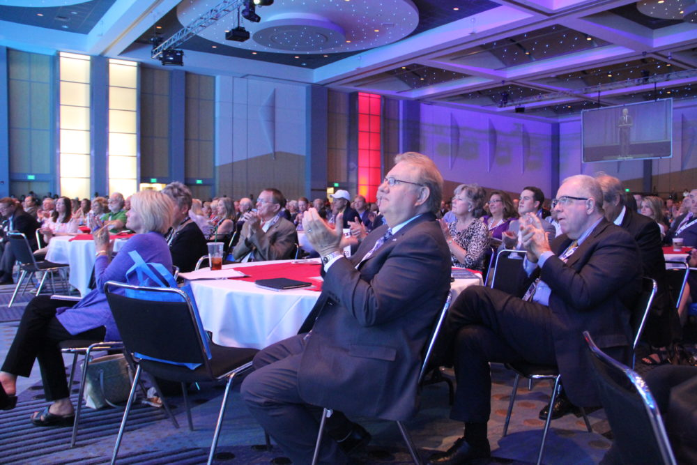 Audience members look on while U.S. Attorney General Jeff Sessions speaks at the Western Conservative Summit in Denver on June 8, 2018. (Esteban L. Hernandez/Denverite)
