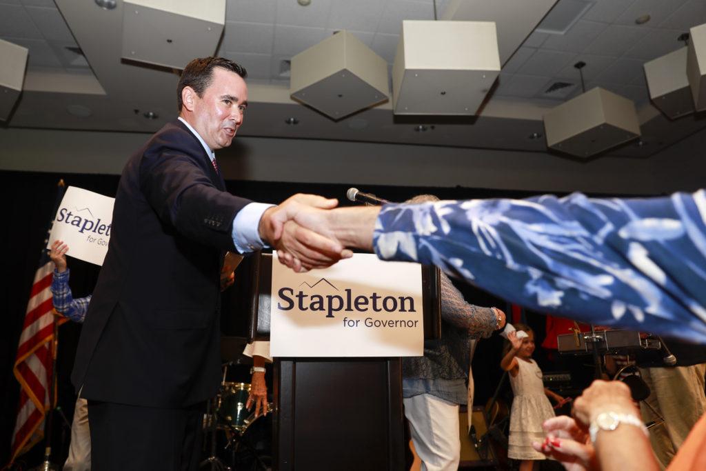 State Treasurer Walker Stapleton celebrates with supporters. (Alyson McClaran/For Denverite)
