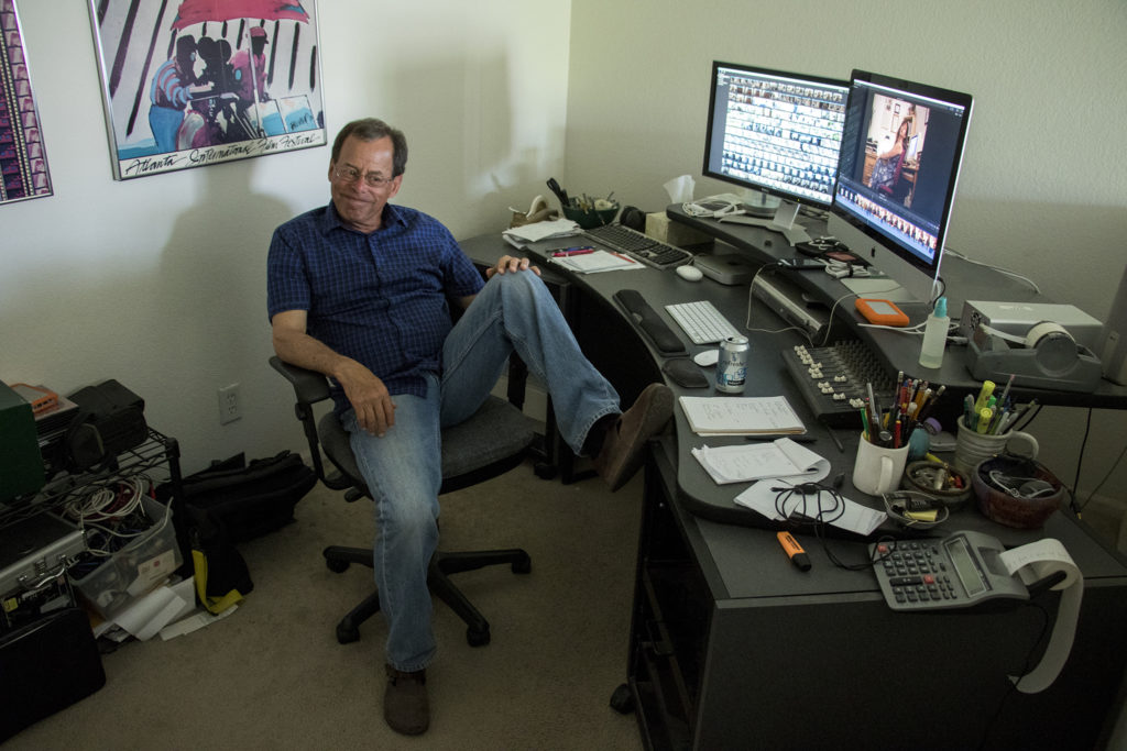Dick Alweis, filmmaker and adjunct documentary professor at the Colorado Film School, chats with a reporter in his editing suite at his home in Denver's Lowry Field neighborhood, July 2, 2018. (Kevin J. Beaty/Denverite)