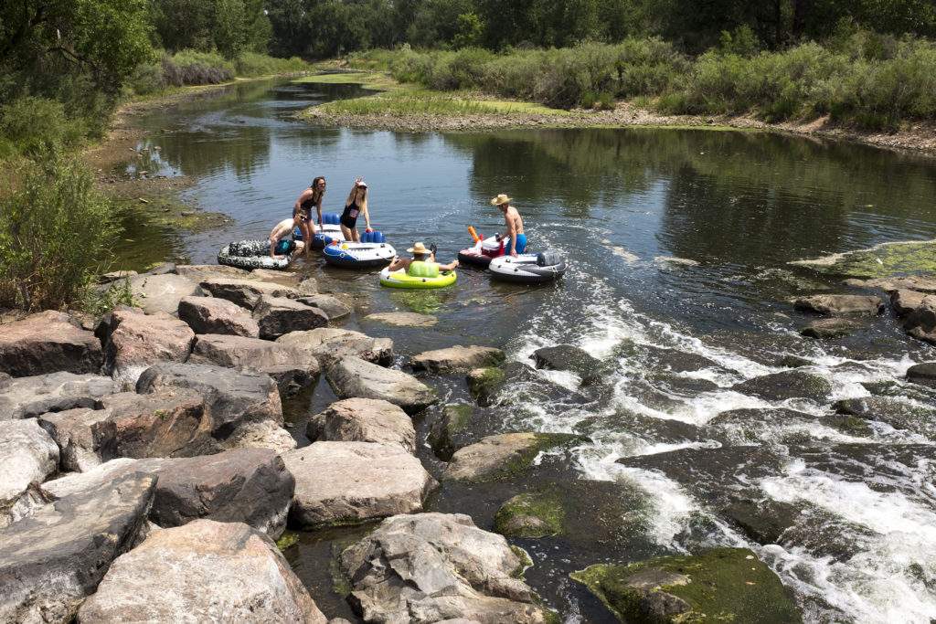 Tubers attempt to float the very low South Platte River at South Platte Park in Littleton, July 4, 2018. (Kevin J. Beaty/Denverite)