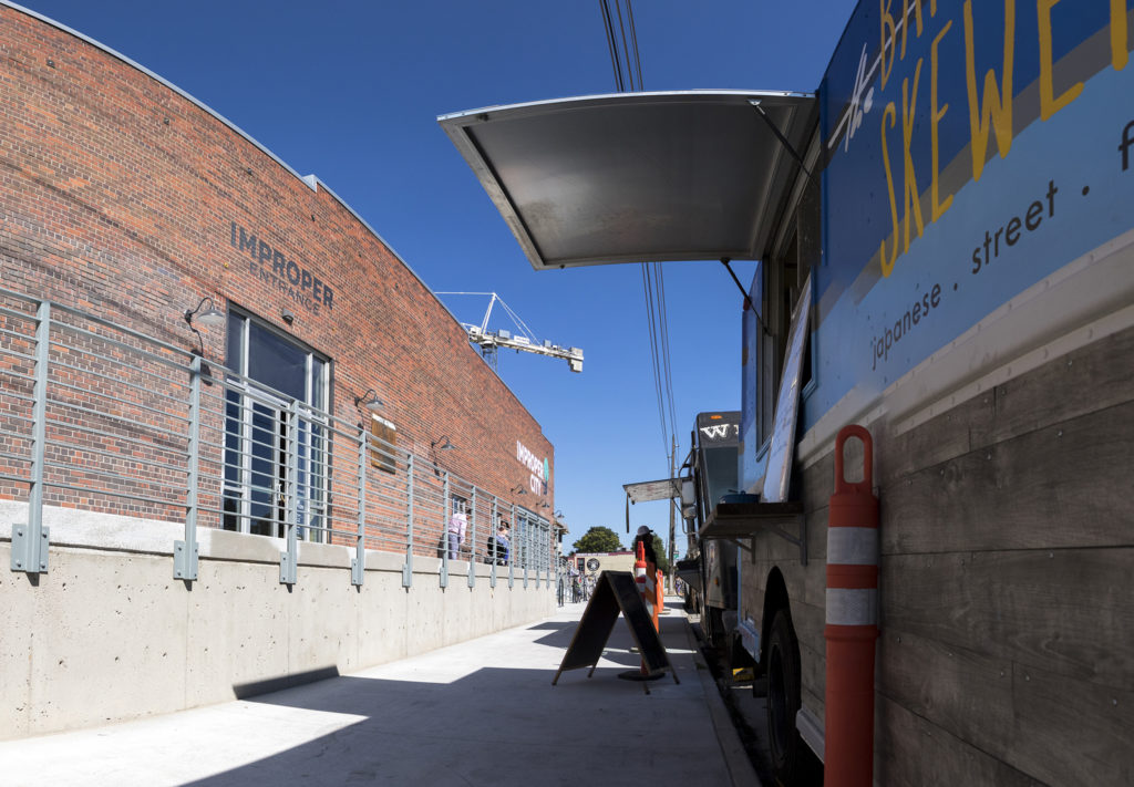 Food trucks outside of Improper City during the soft opening of their new RiNo location. Five Points, July 9, 2018. (Kevin J. Beaty/Denverite)