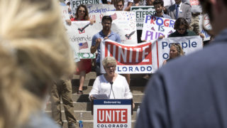 Maile Foster, an independent running for House District 18, speaks at a rally hosted by Unite Colorado supporting five independent candidates running for state offices, July 9, 2018. (Kevin J. Beaty/Denverite)