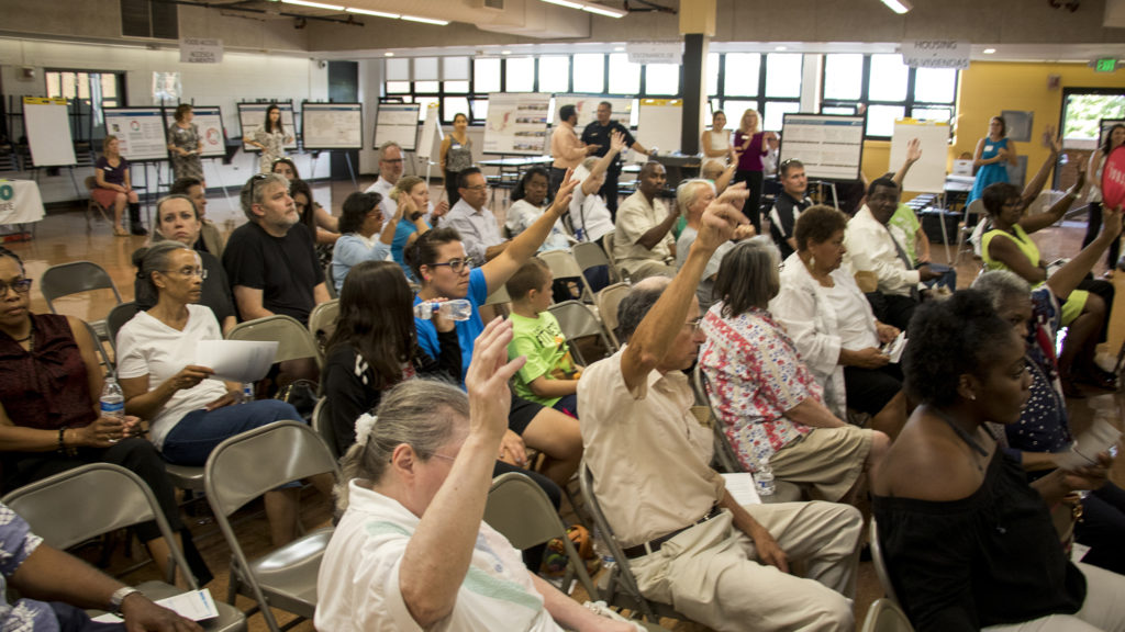A meeting for comments on an early draft of the Far Northeast Area Plan at the Montbello campus cafeteria, July 12, 2018. (Kevin J. Beaty/Denverite)