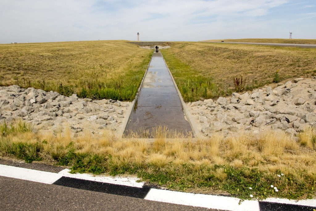 A drainage area on Denver International Airport's airfield that's been re-landscaped to minimize wildlife attractants, July 19, 2018. (Kevin J. Beaty/Denverite)