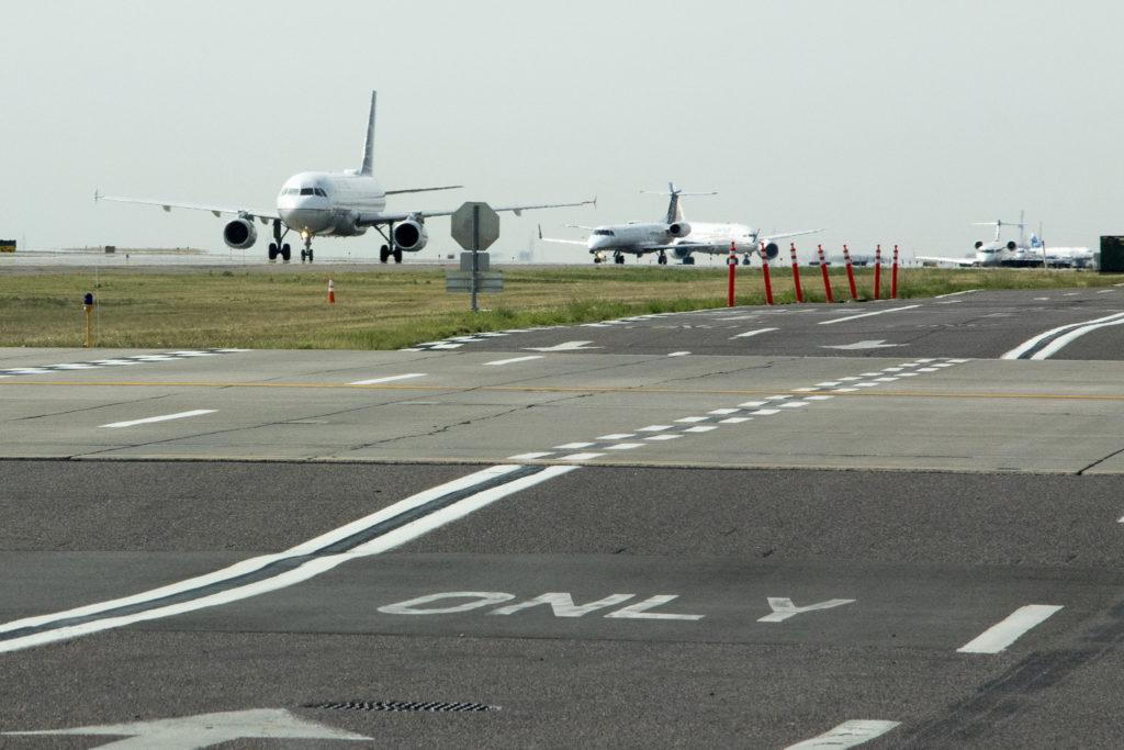 Planes taxi at Denver International Airport, July 19, 2018. (Kevin J. Beaty/Denverite)