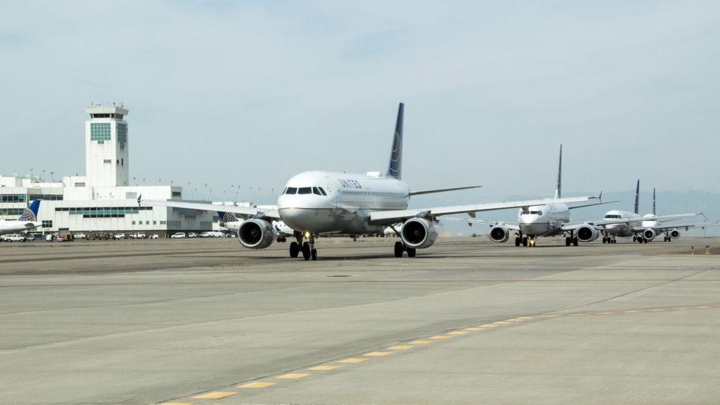 Planes taxi in line at Denver International Airport, July 19, 2018. (Kevin J. Beaty/Denverite)
