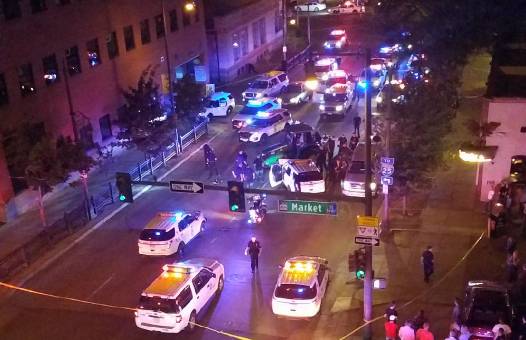 Police surround a stolen tractor on 15th Street downtown, July 20, 2018. (Photo courtesy of Andres Oropeza)
