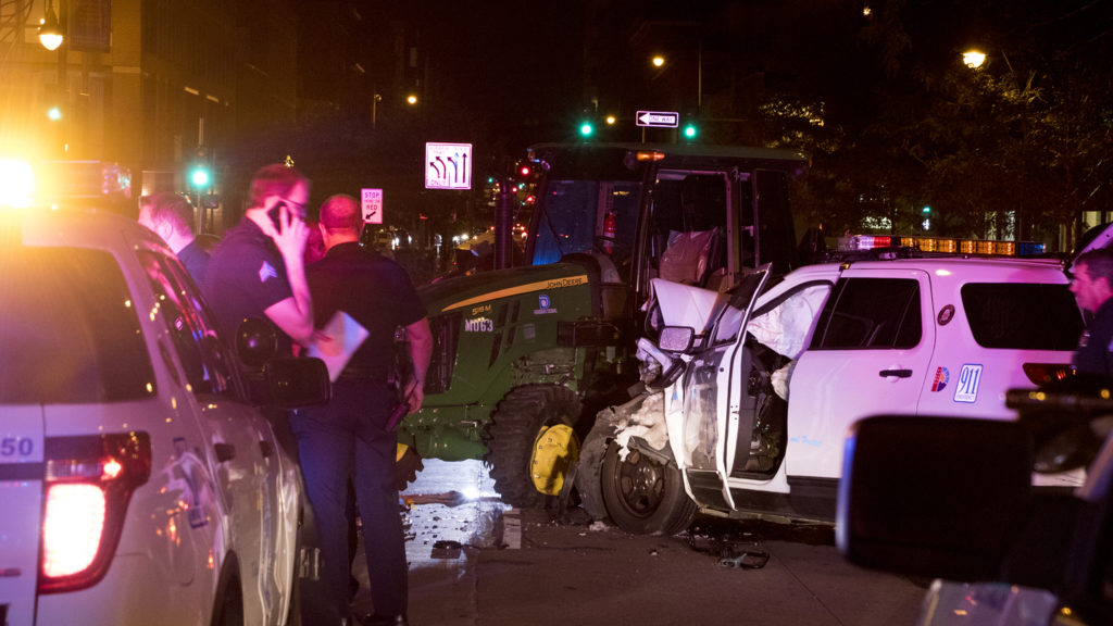 A stolen tractor and ensuing police chase came to an end on 15th Street downtown between Blake and Market Streets, July 20, 2018. (Kevin J. Beaty/Denverite)