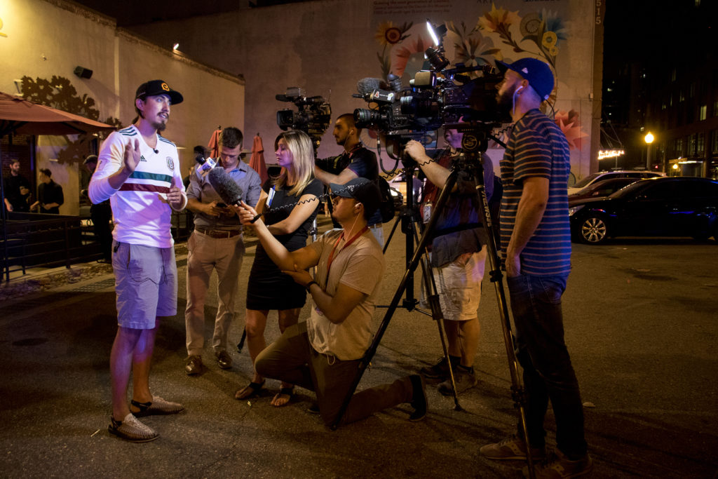 Andres Oropeza speaks to the press after a stolen tractor and ensuing police chase came to an end on 15th Street downtown between Blake and Market Streets, July 20, 2018. (Kevin J. Beaty/Denverite)