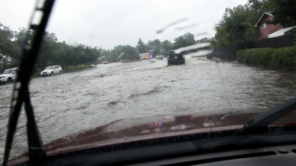 A massive rainstorm causes flooding on Andrews Court in Montbello, July 23, 2018. (Kevin J. Beaty/Denverite)