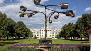 """""""Tree of Transformation,"""" the musical public artwork by Nick Geurts and Ryan Elmendorf, was vandalized with fire at Civic Center Park, July 25, 2018. (Kevin J. Beaty/Denverite)"""