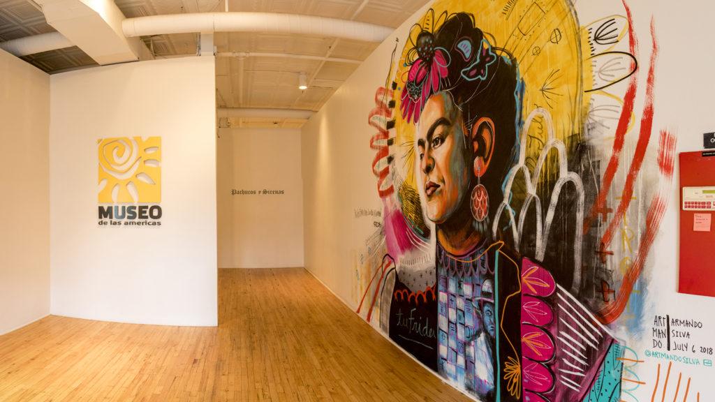 A portrait of Frida Kahlo by Armando Silva on the wall at Museo de las Americas, July 25, 2018. (Kevin J. Beaty/Denverite)