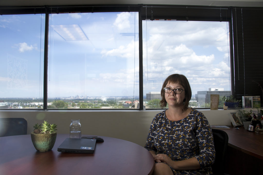 Jennifer Wilson, executive director of the International Rescue Committee Denver, a service provider for refugees, poses for a portrait in her Lakewood office, July 26, 2018. (Kevin J. Beaty/Denverite)