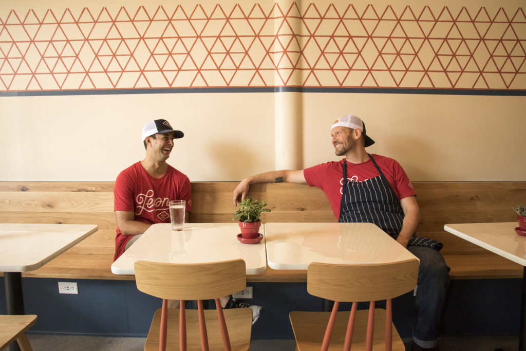 Leven Deli Co. co-owners Anthony Lygizos (left) and Luke Hendricks inside their new location on 12th Avenue, July 27, 2018. (Kevin J. Beaty/Denverite)