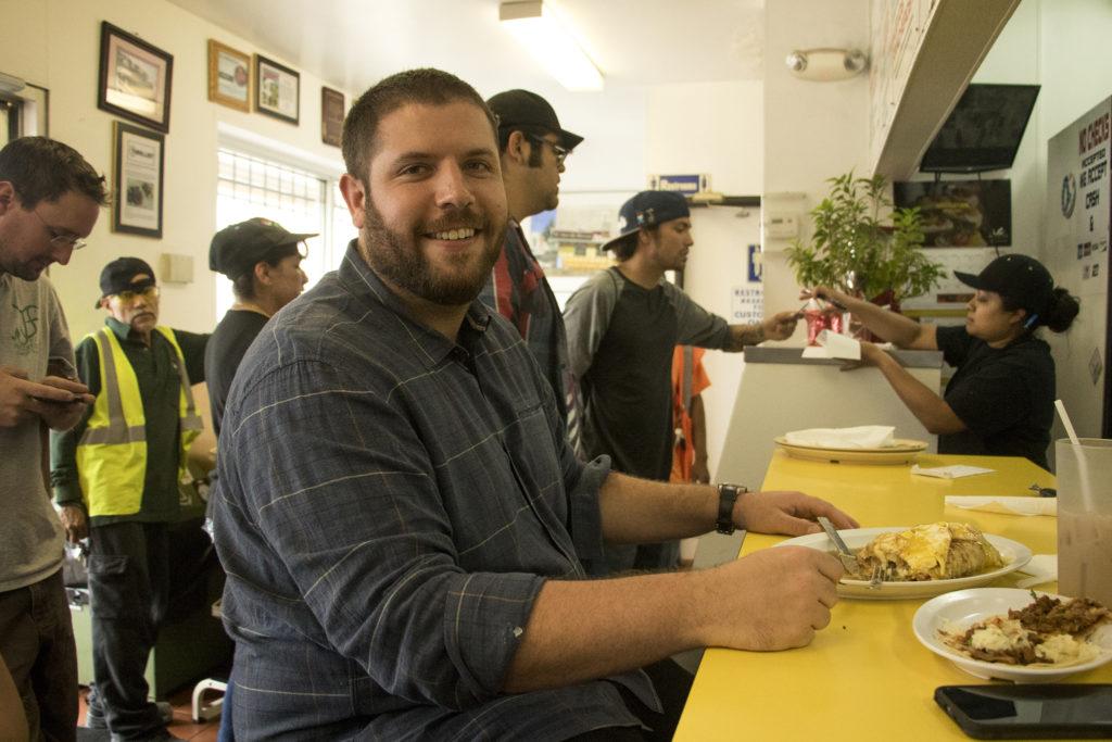 Andrew Goldberg eats at El Taco De Mexico, Santa Fe Drive, Aug. 6, 2018. (Kevin J. Beaty/Denverite)