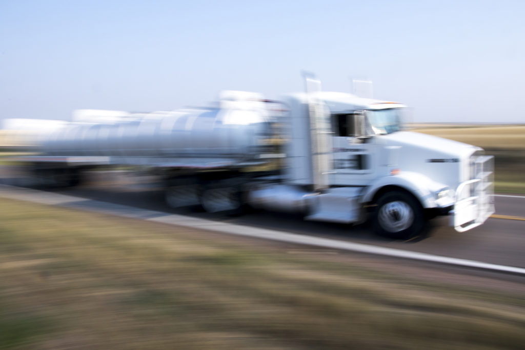 A truck speeds by in Watkins, Colorado, where Bob McCormick set off on his 1,600 mile walk from Denver to Washington, D.C. (Kevin J. Beaty/Denverite)