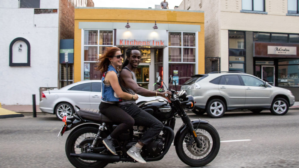 Agata Indiasty rides his motorcycle down Santa Fe Drive, Aug. 2, 2018. (Kevin J. Beaty/Denverite)