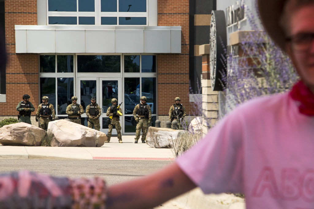 U.S. Immigrations and Customs Enforcement officers emerged equipped with military-style gear as protesters blockaded their headquarters in Centennial, Aug. 2, 2018. (Kevin J. Beaty/Denverite)
