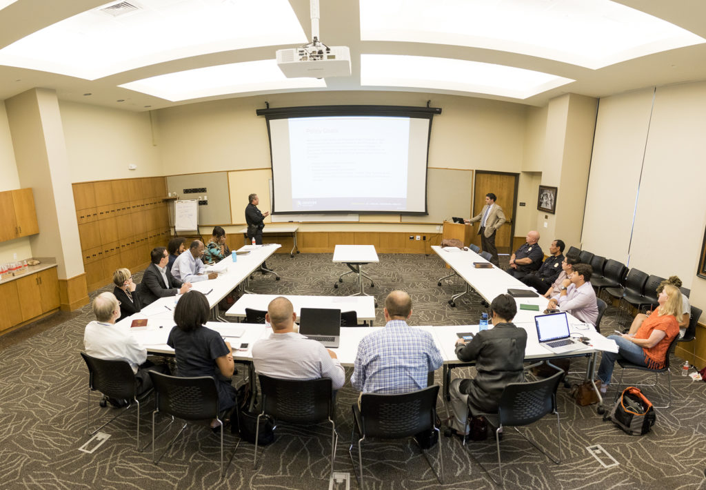 Denver Police Chief Paul Pazen presents his department's new use-of-force policy to a room of community stakeholders at the Blair-Caldwell African American Research Library, Aug. 6, 2018. (Kevin J. Beaty/Denverite)